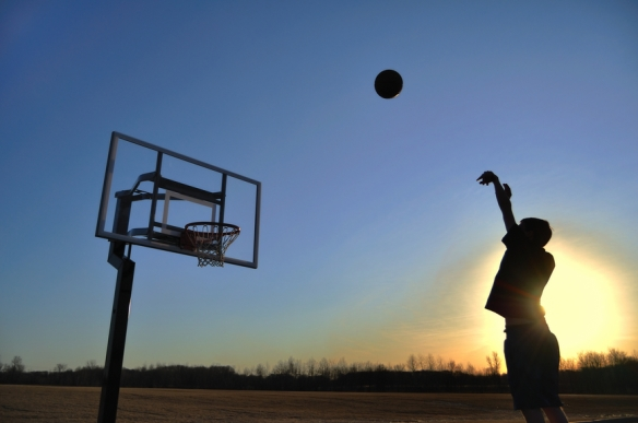 Silhouette of a Teen Boy shooting a Basketball